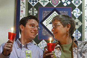Karen Pettigrew of MADD and Jonathan Mueller, a DWI Survivor, at the Candlelight Vigil in 2008, share a happy moment as Crime Victims' Right's Week begins.